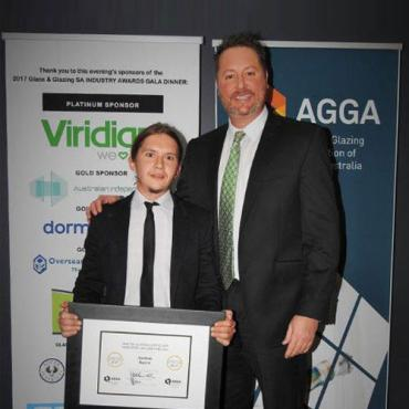 Glass Industry Apprentice of the year receiving his reward