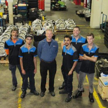 Automotive apprentices with their employer